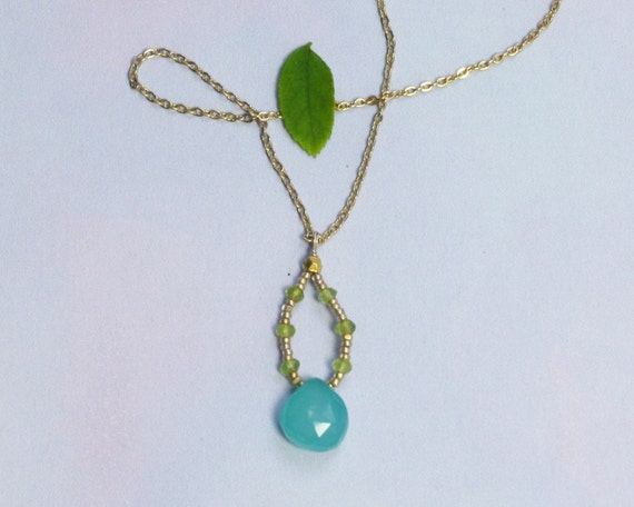 Pobble: Sea green chalcedony necklace. A delicate  necklace with gold seed beads and peridot beads