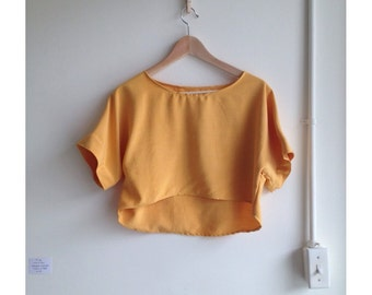 Mango silk crop top. Raw silk cropped blouse in buttery sunflower gold. Size S-M.