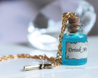 Alice In Wonderland necklace. Drink Me. Bottle Necklace. Bottle charm. Glass vial. vial charm. drink me charm. blue. cute. gold key. pendant