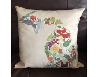 Michigan Map with Local Products Throw Pillow on Light Brown Background
