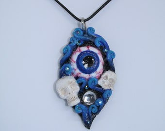 blue eyeball surrounded by blue swirls and skulls aurora borealis crystals and clear gems