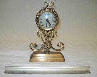 Antique brass clock with new movement.