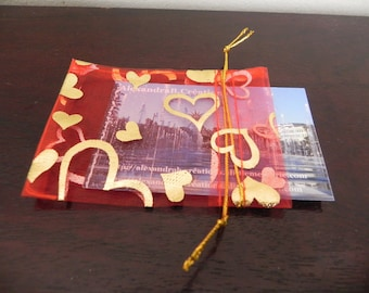 set of 99 Golden red sachets in organza with hearts