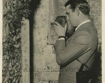 Actor photographer with movie camera antique photo
