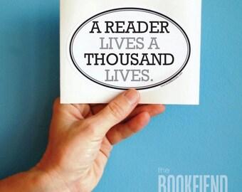 a reader lives a thousand lives oval bumper sticker