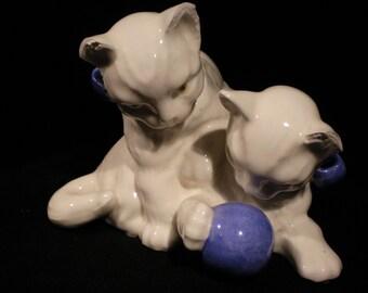 White Ceramic cats with yarn