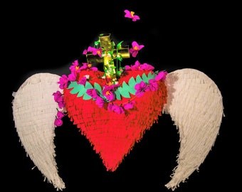 and then her heart grew wings pinata