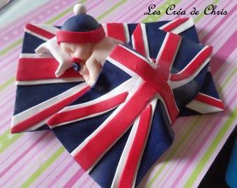 "mixed polymer clay baby sleeping on his ""English"" flag."