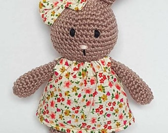 Handmade crocheted bunny in a floral dress