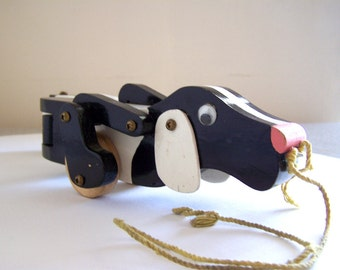 Vintage Toy handmade wood dog pull toy black and white