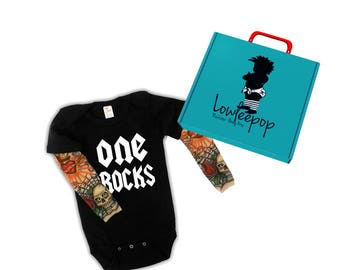 One Rocks black onesie with tattoo sleeves. Great for a 1st birthday photo shoot! Optional Gift Box