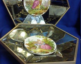 A Set of Fragonard Porcelain Wall Plaques