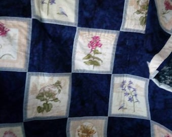 A  lap sized Quillow (quilt with attached storage pillow)