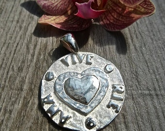 """Spanish for  """"Live - Laugh - Love"""" .  Sterling silver medals."""