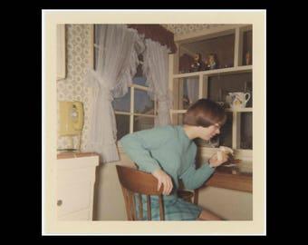 1968 Vintage Kodacolor Print Snapshot Photo: Girl Eating Banana in Kitchen (74570)