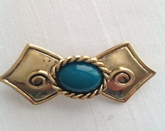 Bow shaped brooch in goldtone