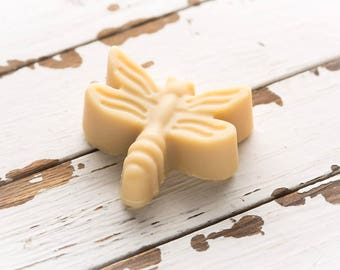 organic goat milk soap in the shape of a dragonfly