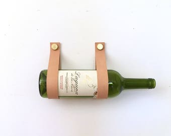 Wine Straps leather and brass wall mount wine holder and magazine rack