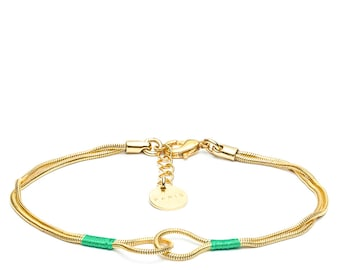Handcuff bracelet gold chain and green thread