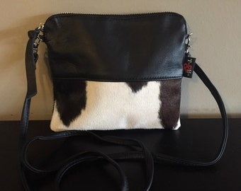 Cow Hide Cross Body Bag.Lambskin leather and cow hide bag with removable straps.Can be a clutch bag or cross body.Cotton lining,quality made