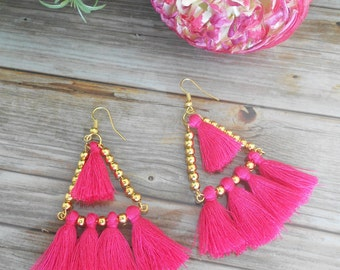 Earrings with pink pompoms. Golden Earrings with pink tassel
