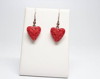 Red Carved Hearts with bronze fishhooks