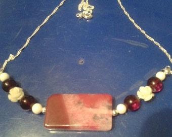 Red Agate with garnet, white jade,and carved white Coral Roses on a Sterling Silver Chain