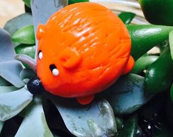 Mini marble Hedgehog of Hedgehog Bog shown in solid orange