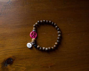 Wooden beads and pink peace bracelet