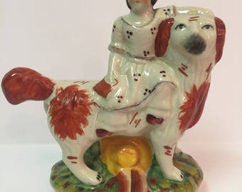 Staffordshire style girl with dog