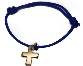 Cross on cord bracelet - gold plated