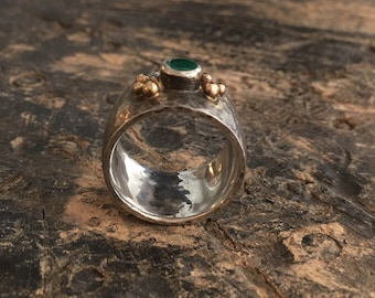 Emerald Ring of blackened, hammered silver with golden balls