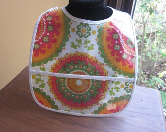 WATERPROOF WIPEABLE Baby to Toddler Wipeable Plastic Coated Bib Orange, Olive and Cream Circular Print