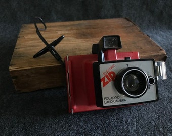 Great vintage Polaroid Land Camera Electric Zip red