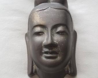 Brass Buddha wall hanging