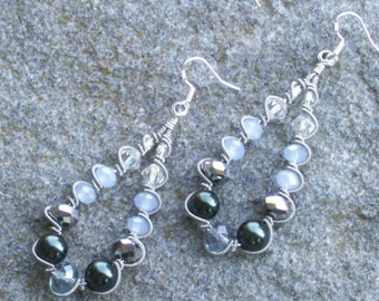Silver wire wrapped earrings with silvery  and blue crystals , deep blue pearls    silvery coils