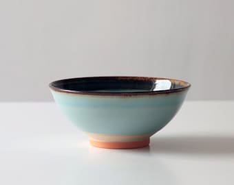 Blue Ceramic Bowl with dark rim and orange foot