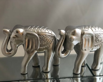 Wooded silver elephant with raised trunk