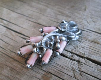 metal brooch with coral