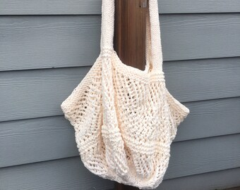 Cream hand knitted beach or market bag.