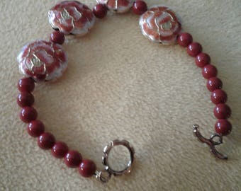 Dark red beads with flower beads
