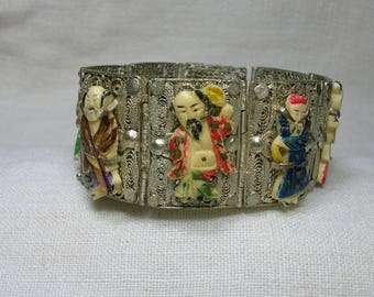 Chinese filigree bracelet with bone 8 immortals. Silver plated, early 20th c