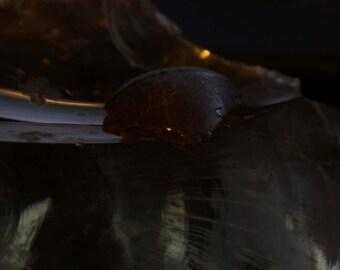 Faded brown glass shard from Keuka Lake
