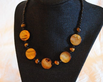 Black and Brown beaded necklace with iridescent disk beads