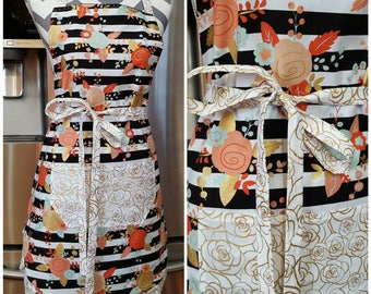 Adult apron. Woman's apron. Black and white stripes with floral. Gold floral with white backing on pocket, ties and frills.