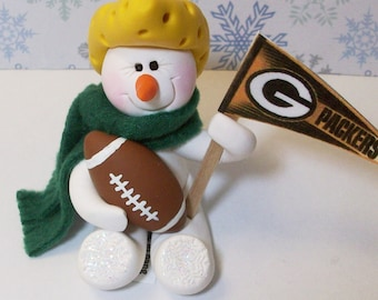 Cheese head packers: snowman ornament