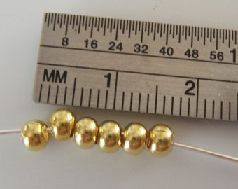 100-  Yellow Brass Donut Spacers