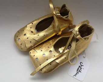 Gold baby ballet shoes