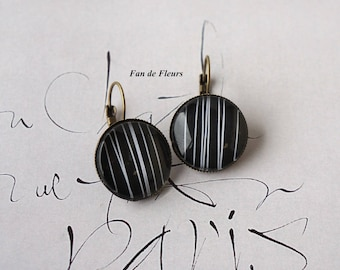 Earrings sleepers patterned thin white lines on black background