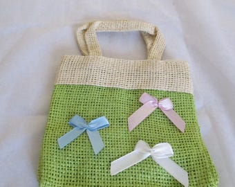 small green linen with three small knots stitched bag